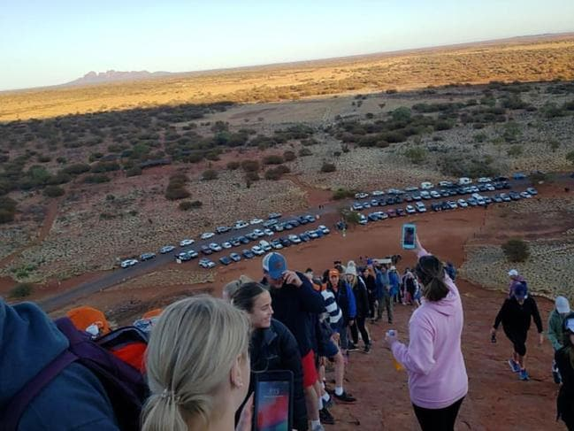 Tourists snap pictures of themselves and the car park below. Picture: @koki_mel_aus