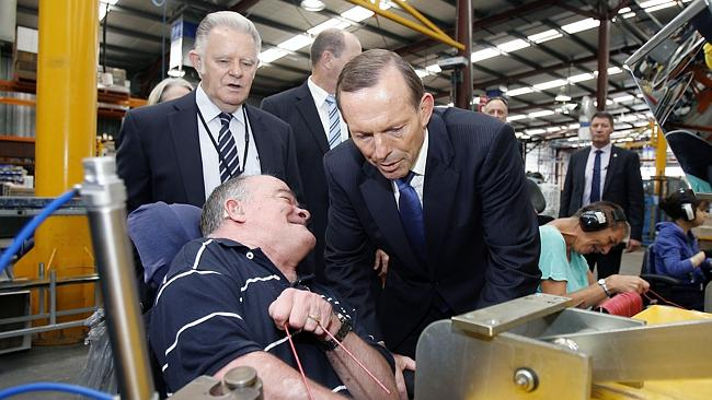 Trial ... Prime Minister Tony Abbott visits the Goodwill Industries in Perth with WA Premier Colin Barnett.