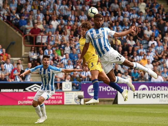 Chelsea's Spanish defender Marcos Alonso (C) vies with Huddersfield Town's Beninese striker Steve Mounie (R). Picture: AFP