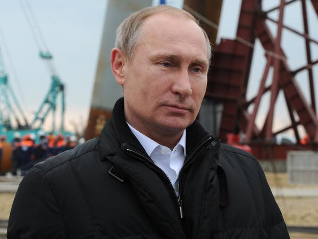 Putin addresses people marking the second anniversary of Russia's annexation of the Black Sea peninsula in central Moscow in March this year. Picture: Mikhail Klimentyev