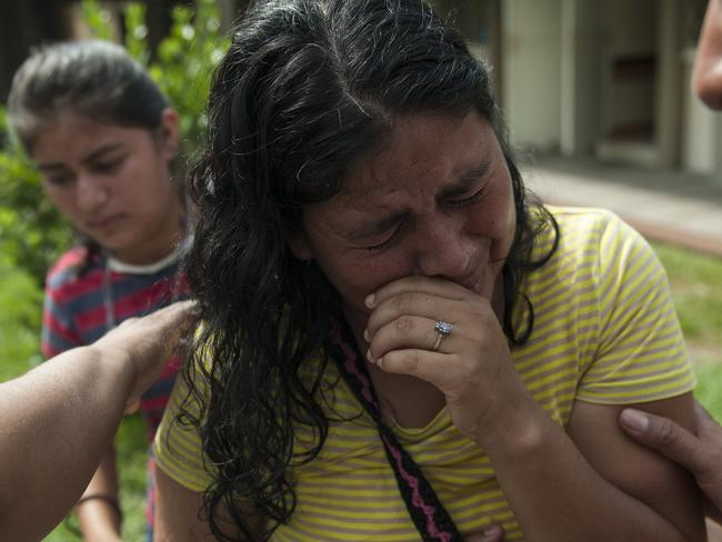 Lilian Hernandez wept as she spoke about her missing family. Picture: AP