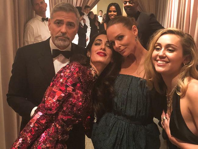 George Clooney, Amal Clooney, Stella McCartney and Miley Cyrus during the 2018 Met Gala in New York City. Picture: @stellamccartney/Instagram