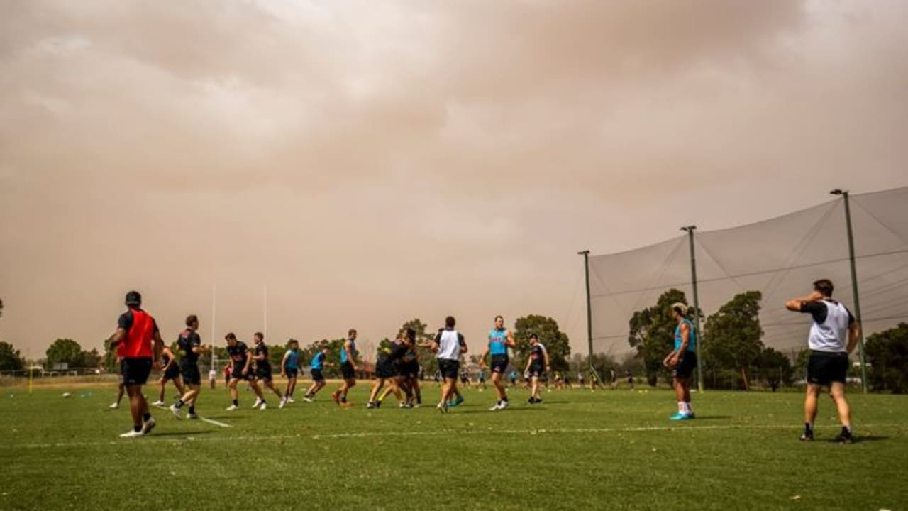 Panthers players train during the dust storm. Photo: Penrith Panthers