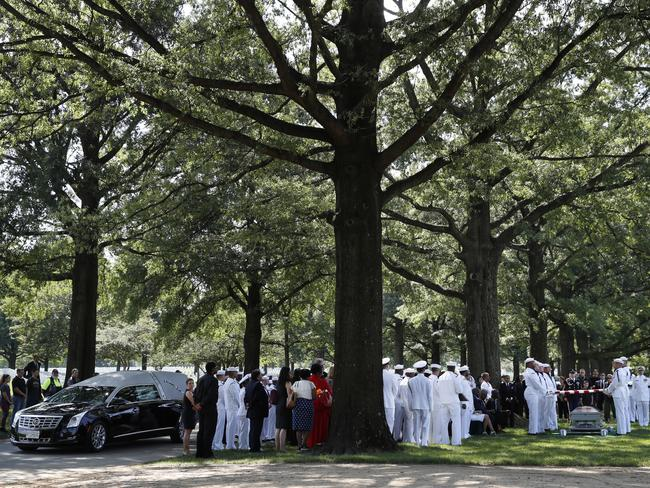 Family and friends attend a burial service at Arlington National Cemetery in Arlington, Virginia, for one of the sailor who died when the USS Fitzgerald collided with a container ship. Picture: AP