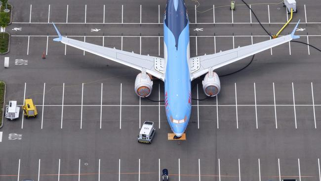 A Boeing 737 MAX plane is stored on an employee parking lot adjacent to Boeing Field in Seattle, Washington. The top-selling plane has been grounded worldwide since March 13 following a second devastating crash. Picture: Stephen Brashear/Getty Images/AFP.