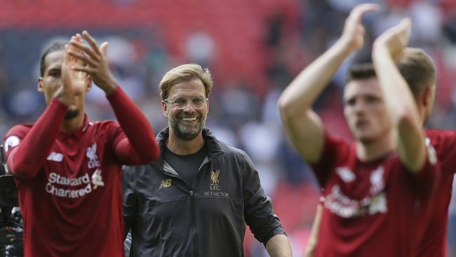 Liverpool's coach Jurgen Klopp center, celebrates with Liverpool's players