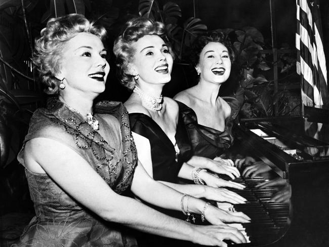 Zsa Zsa Gabor (centre) with her sisters Eva (left) and Magda in January 1954. Picture: AFP