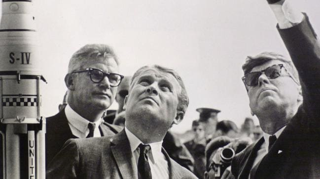 NASA deputy administrator Doctor Robert Seamans (left) and Doctor Wernher von Braun (centre) look skywards with US president John F Kennedy at Cape Canaveral in 1963.