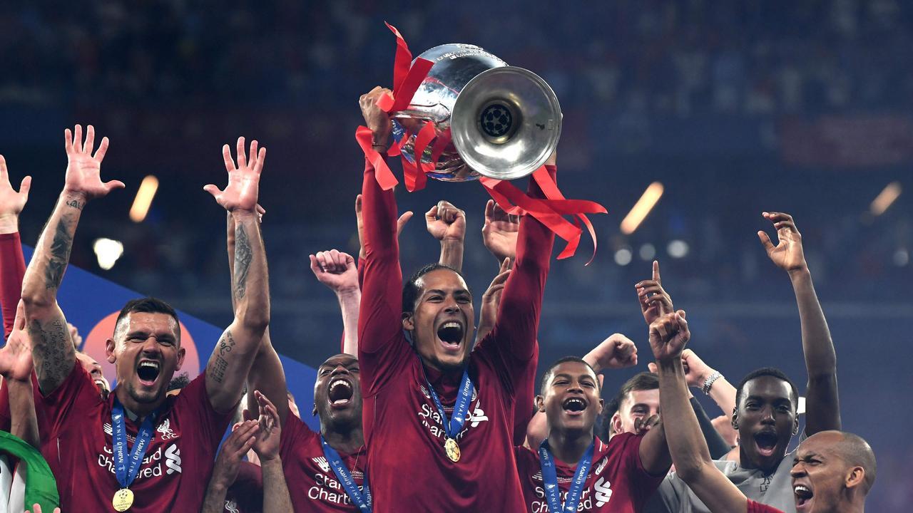 Virgil van Dijk lifts the Champions League trophy