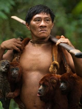 One of the Huaorani people with the monkeys he has hunted for food. Picture: Pete Oxford / mediadrumworld.com