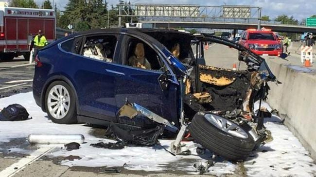 An Apple engineer who died when his Tesla Model X crashed into a concrete barrier complained before his death that the car's autopilot system would malfunction in the area where the crash happened. Picture: KTVU-TV / AP