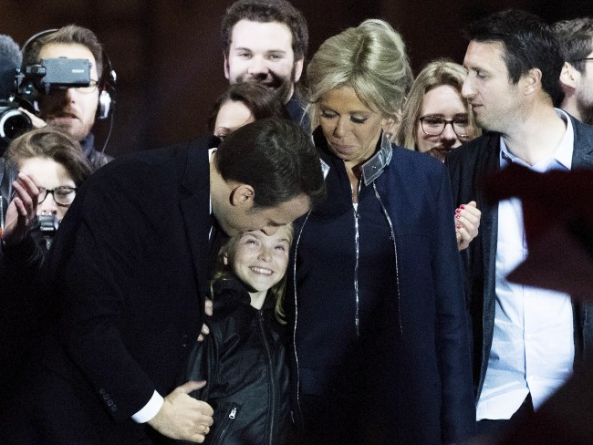 Emmanuel Macron addresses supporters with wife Brigitte Trogneux (R) and her daughter Tiphaine Auziere (C) after winning the French Presidential Election. Photo: David Ramos/Getty Images
