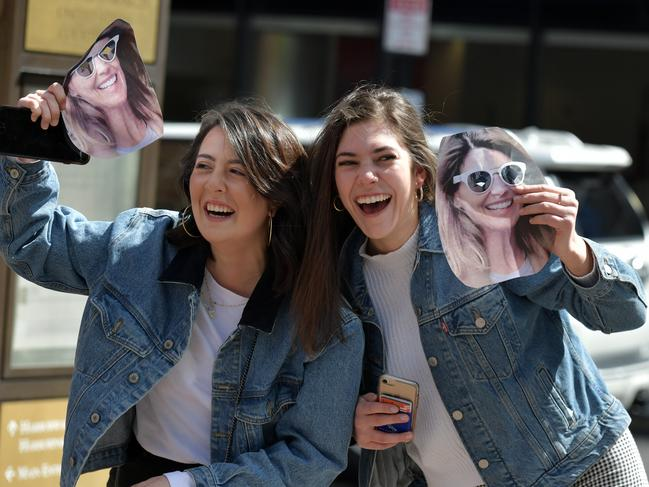 Fans of Lori Loughlin hold photo masks of the actress. Picture: Paul Marotta/Getty Images