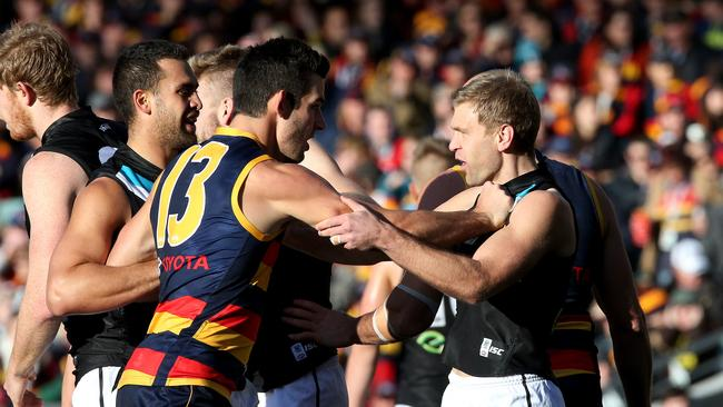 Taylor Walker and Kane Cornes face off in Showdown 37 in 2014. Picture Simon Cross