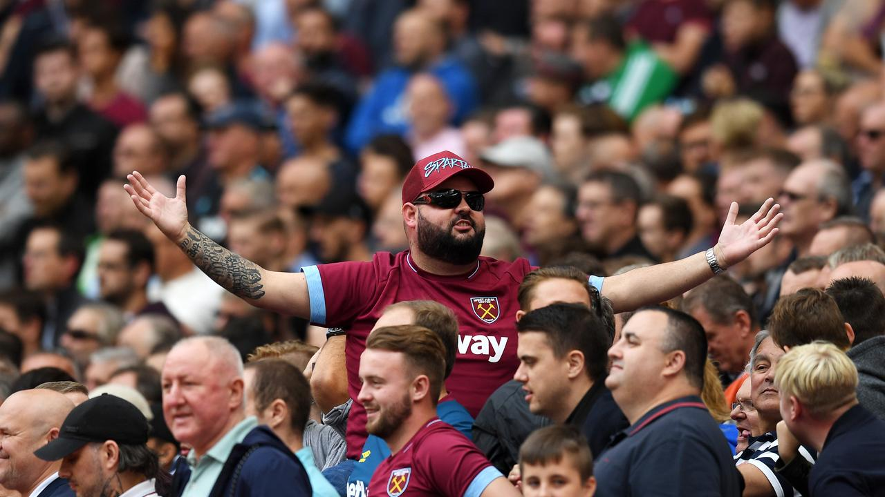 A West Ham fan doesn't look too happy.