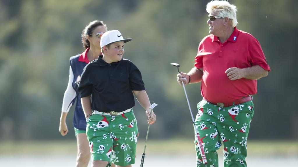 11af2c810 Little John Daly and his father John Daly share a smile during the first  round of