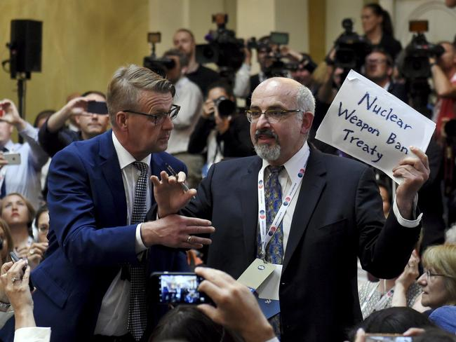 The protester claimed to be a journalist from The Nation before he was dragged out of the room. Picture: Antti Aimo-Koivisto/Lehtikuva via AP