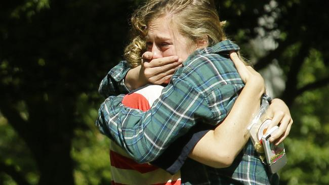 Two women embrace near a prayer circle on the campus of Seattle Pacific University, Friday, June 6, 2014. Picture: Ted S. Warren