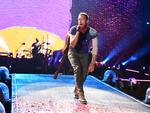 Chris Martin out front of Coldplay at Suncorp Stadium, Brisbane, on December 6. Pic: Dan Peled/AAP