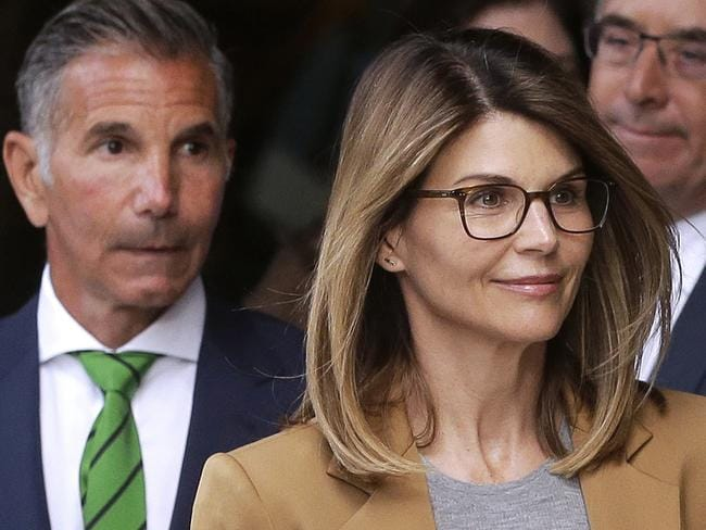 Lori Loughlin, right, with husband Mossimo Giannulli outside court. Picture: AP