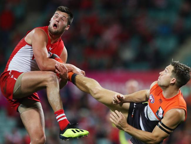 Toby Greene kicks Sydney's Nic Newman to mark a ball. Picture. Phil Hillyard