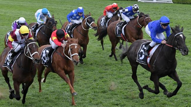Avilius (right) unleased an impressive turn of foot to win the Kingston Town Stakes. Picture: AAP