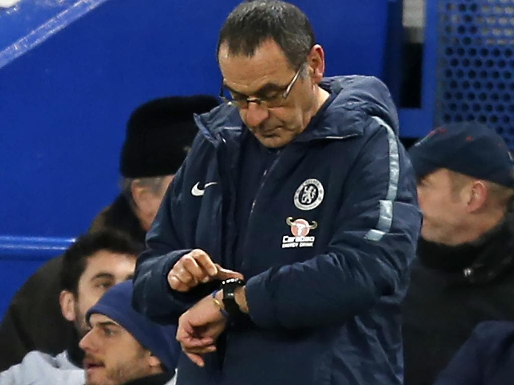 Chelsea's Italian head coach Maurizio Sarri checks his watch on the touchline during the English FA Cup fifth round football match between Chelsea and Manchester United at Stamford Bridge in London on February 18, 2019. (Photo by Ian KINGTON / AFP) / RESTRICTED TO EDITORIAL USE. No use with unauthorized audio, video, data, fixture lists, club/league logos or 'live' services. Online in-match use limited to 120 images. An additional 40 images may be used in extra time. No video emulation. Social media in-match use limited to 120 images. An additional 40 images may be used in extra time. No use in betting publications, games or single club/league/player publications. /