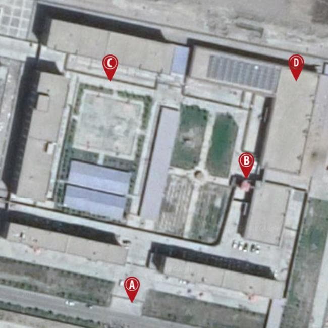 The 'vocational training' facility allegedly being used to detain and 're-educate' Muslim Uighurs. A) The guarded gate. B) The red-roofed watch tower. C) Part of the tall concrete-and-wire wall D) Dormitories. Picture: Google Earth