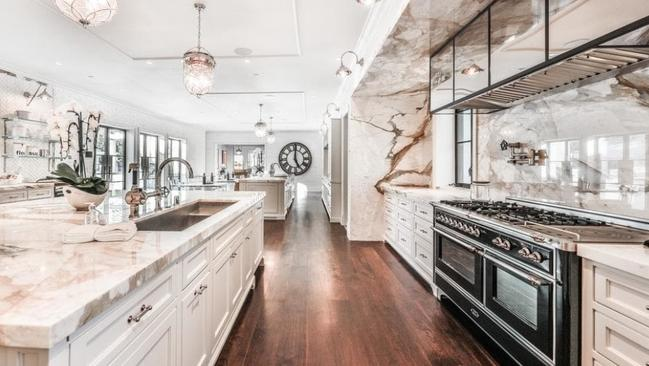 There is an expansive marble kitchen.
