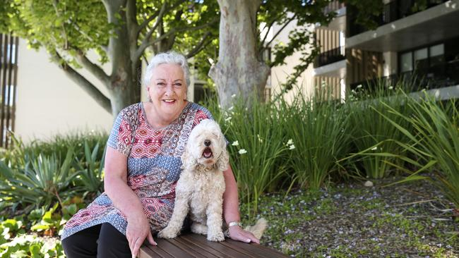 Kerry Paul, with dog Joey, bought a new Toga unit in Balmain to enjoy a lower maintenance lifestyle. Picture: Justin Lloyd.