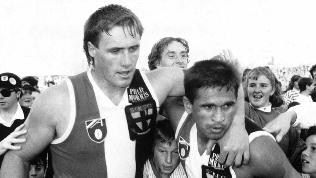 Tony Lockett and Winmar are mobbed by fans after winning by 131 points over the Adelaide Crows in 1994.