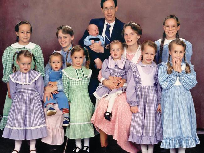 Rachel, front right, with her family at the age of eight, the year her father first forced her to perform a sex act on him.