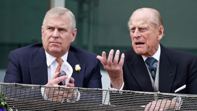Prince Andrew with Prince Philip.