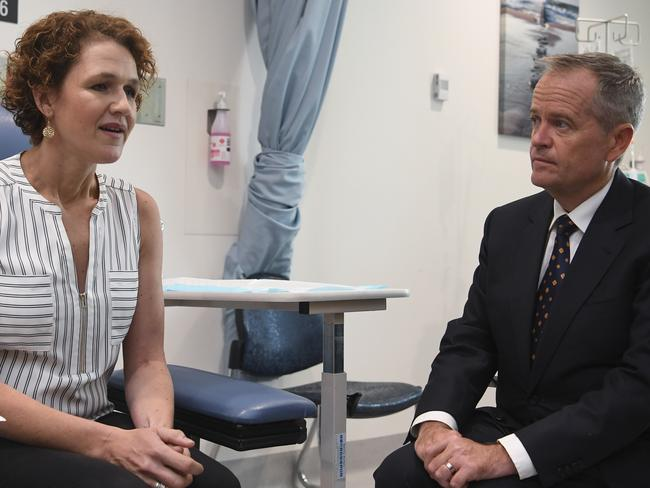 Australian Opposition Leader Bill Shorten speaking to cancer patient Sarah McGoram at the Cancer Centre at Canberra Hospital in Canberra, Friday, April 5, 2019.