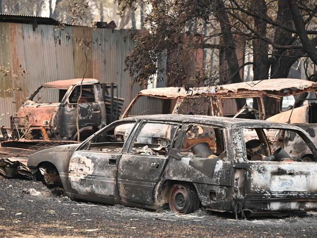 The burnt-out remains of cars and property at Old Bar. Picture: Peter Parks/AFP