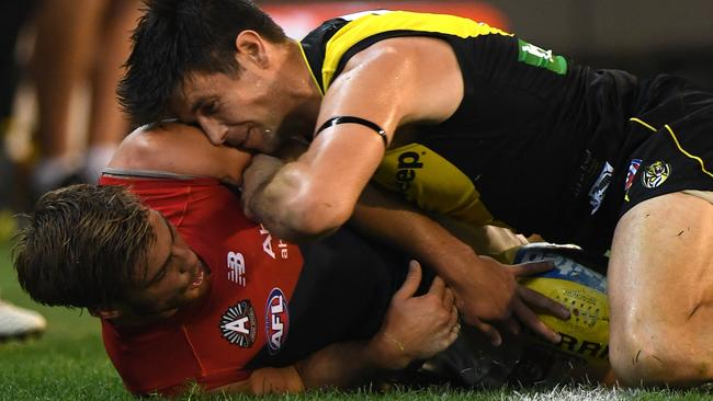Trent Cotchin got up close and personal with Jack Viney during last year's Anzac Eve clash.