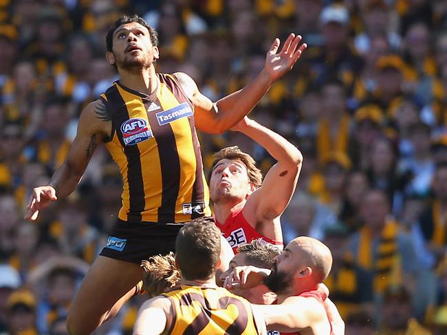 Cyril Rioli is fit and firing and climbed high in this marking contest. Pic Quinn Rooney/Getty Images