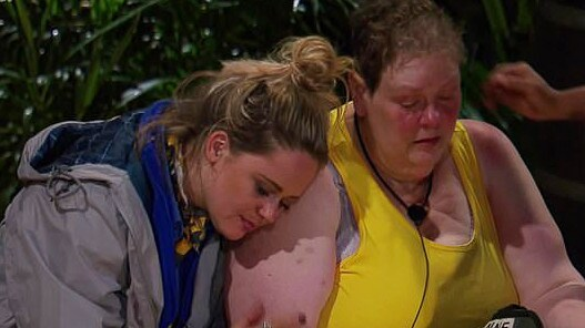 The Chase star Anne Hegerty being consoled by Emily Atack.