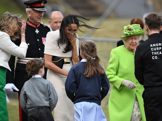 Meghan, Duchess of Sussex, speaks to a girl in the town of Widnes in Halton, Cheshire, England. Picture: Getty