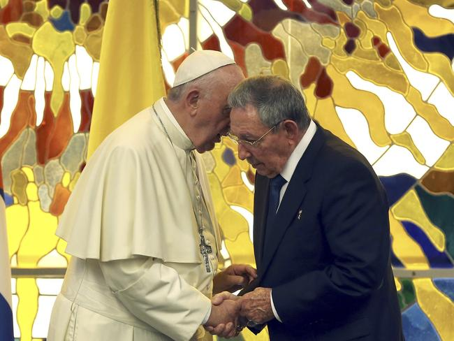 Pope Francis shakes hands with Cuba's President Raul Castro ... Raul, an atheist, said he likes the pope so much he is thinking of returning to his Catholic roots. Picture: Alejandro Ernesto/Pool via AP