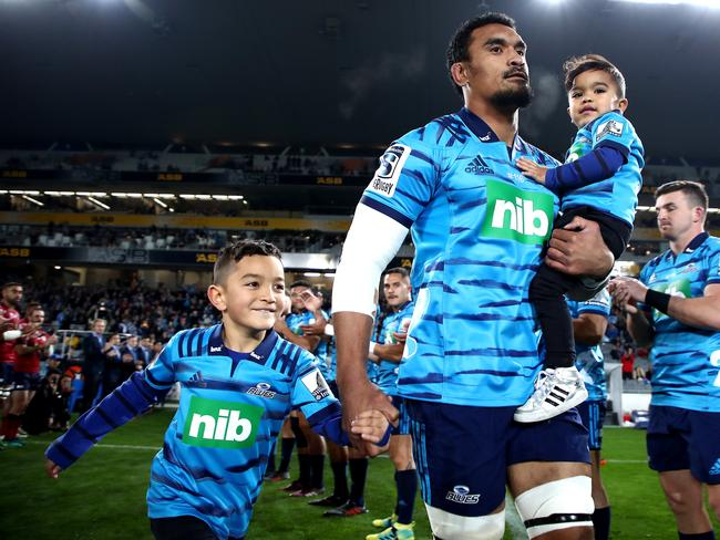 Jerome Kaino runs out onto the field with his children. Pic: Getty
