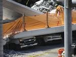 Vehicles are seen trapped under the collapsed pedestrian bridge that was newly built over southwest 8th street allowing people to bypass the busy street to reach Florida International University on March 15, 2018 in Miami, Florida. Picture: Joe Raedle/Getty Images/AFP