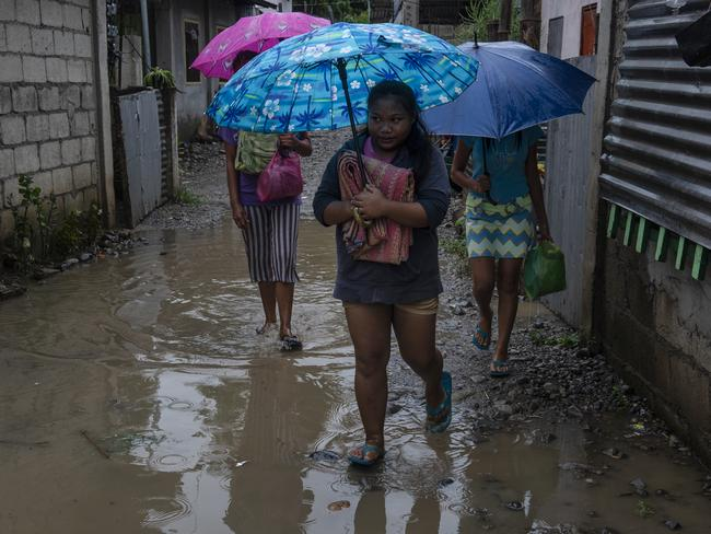 Residents evacuate to safer grounds as Typhoon Mangkhut approaches on September 14, 2018 in Tuguegarao city, northern Philippines. Picture: Jes Aznar/Getty Images