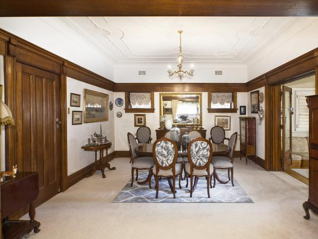 The separate formal dining room also has period features.