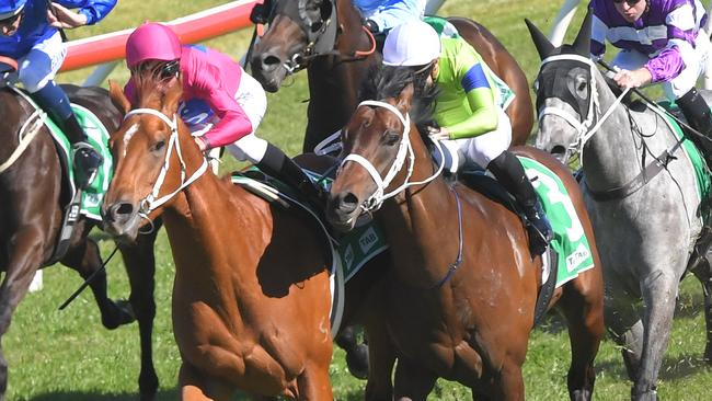 True Detective (right) won the Up And Coming Stakes after winning a protest against Superium. Picture: AAP