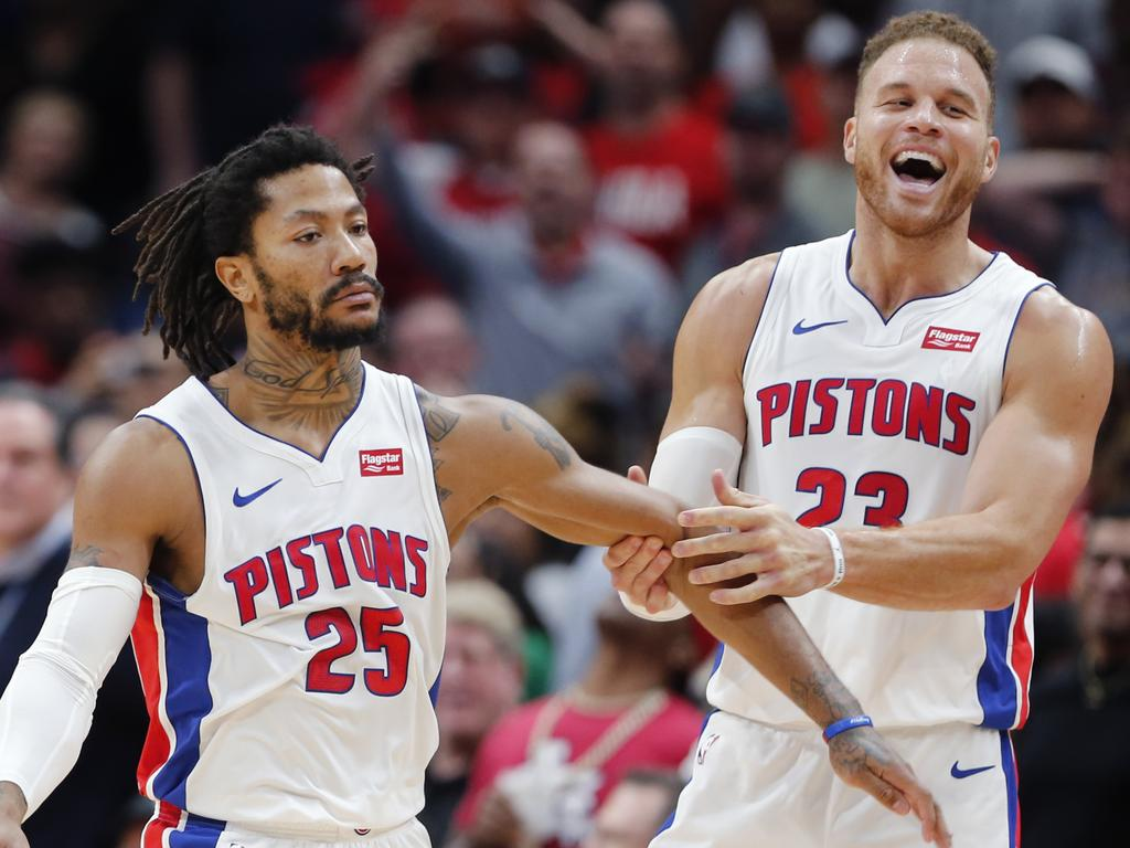Detroit Pistons guard Derrick Rose (25) celebrates the game winning score with forward Blake Griffin (23) in the second half of an NBA basketball game in New Orleans, Monday, Dec. 9, 2019. (AP Photo/Brett Duke)