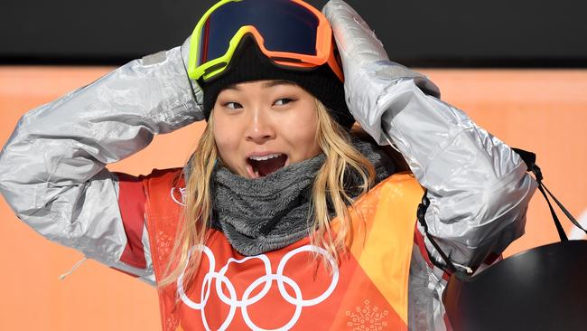 Chloe Kim of the United States reacts to her first run score.