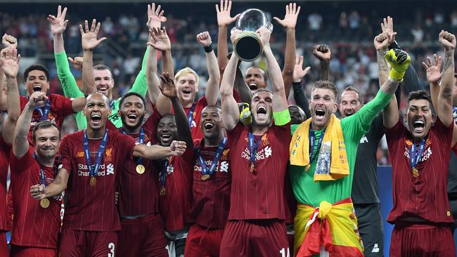 Jordan Henderson lifts the UEFA Super Cup trophy as Liverpool celebrate victory. Picture: Getty