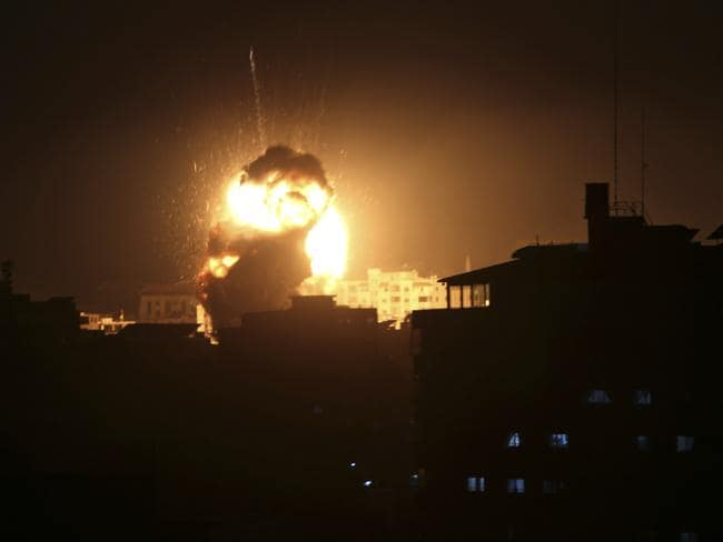An explosion caused by Israeli air strikes is seen from the offices of Hamas leader Ismail Haniyeh, in Gaza City. Picture: AP