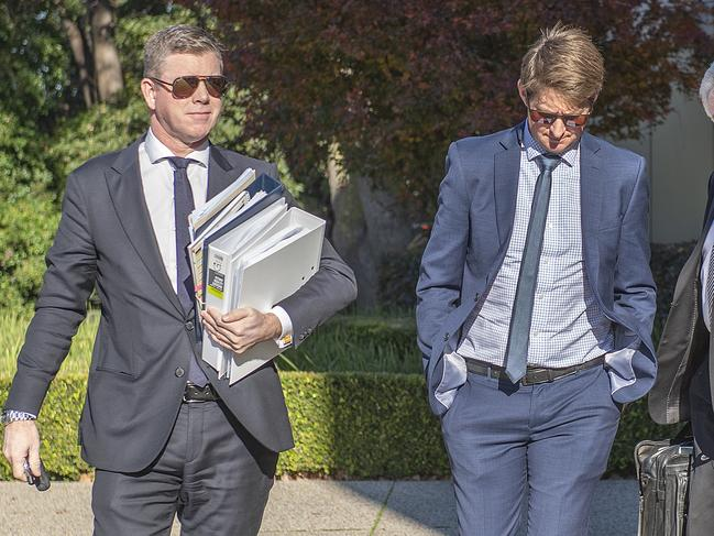 Victorian trainer Jarrod McLean (right) leaves the Racing Appeals and Disciplinary Board after his case was adjourned.